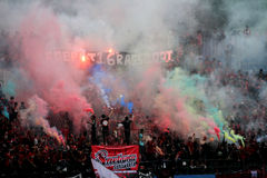 Football fans. Supporters of the football club to celebrate the victory of his team in a stadium in the city of Solo, Central Java, Indonesia Royalty Free Stock Photography