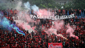 Football fans. Supporters of the football club to celebrate the victory of his team in a stadium in the city of Solo, Central Java, Indonesia Royalty Free Stock Photo