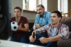 Football Fans Watching Match at Home Stock Photography