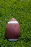 Football on field stock images