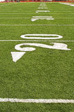 Football Field. Detail of an American football from player's perspective Royalty Free Stock Photos