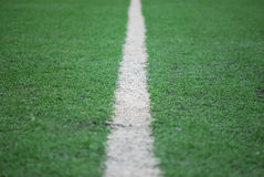 Football Field. A closeup photo taken on a football field line paint marking Stock Images