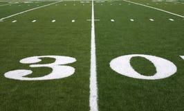 Football Field 30 Yard Line. Thirty yard line on an American football field Stock Photo
