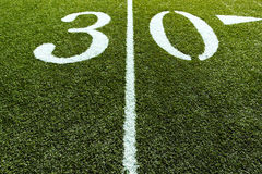 Football Field 30 Yard Line. 30 Yard Line of Football Field with Line splitting the frame stock image
