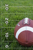 Football on a field Stock Image
