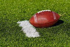 Football on Field. Football on a single yardage marker. Low, horizontial view royalty free stock photo