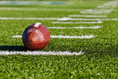 Football on Field. Football on Yardage Marker. Low Angle. Horizontial View royalty free stock photo