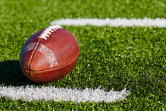 Football on Field. Football on Yardage mark. Shallow DOF. Horizontial View stock image