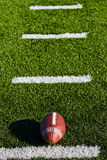 Football on Field. Football on Yardage Marks. Vertical View royalty free stock photography