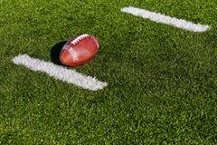 Football on Field. Football on Yardage Marker. Horizontial Stock Image