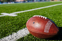 Football on Field Stock Photo