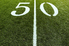 Football Field on 50 Yard Line. 50 Yard Line with Line splitting the frame stock photo