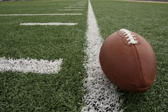 Football on the field. Football with no logos on the field with room for copy Royalty Free Stock Photography