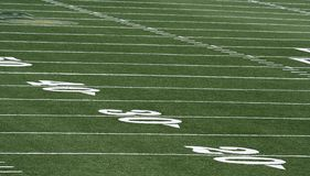 Football field. Grass and yard lines Stock Image