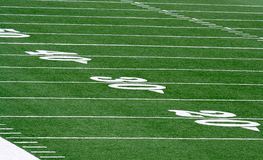 Football field. Grass and yard lines Royalty Free Stock Photography