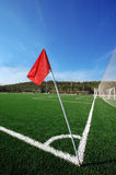 Football field. Corner flag and green grass Royalty Free Stock Photo