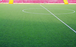 Football field. A green football field with red chairs Royalty Free Stock Photography