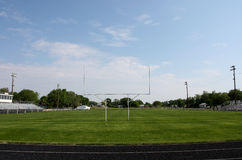 Football Field. Goal posts and football and track field in small town Stock Photos