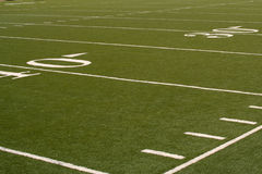 Football Field. Yard-lines on an American football field.  Green grass and white lines with hash marks Royalty Free Stock Photography