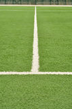 Football field, artificial turf. Central line platform for playing soccer, white stripe, green, line out stock image
