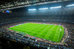 Football field and audience at stadium Nou Camp, Barcelona. BARCELONA, SPAIN - NOVEMBER 04, 2015: Above view at field and audience during football game between Stock Image