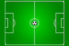 Football field with ball. In the centre Royalty Free Stock Photos