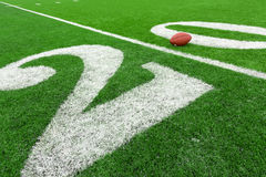 Football field with ball Stock Photography