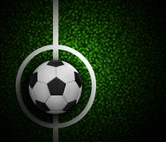 Football field with ball and a grass texture. Royalty Free Stock Photo