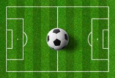 A football field with a ball in the middle Stock Image