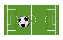 Football field and ball. Soccer game. Game ball high above groun Royalty Free Stock Photography