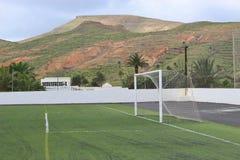 Football field in beautiful landscape. Royalty Free Stock Photo