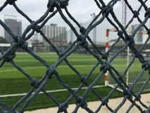 Football field behind net. Football field outdoor behind net Stock Photos