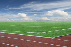 Football field and blue sky Royalty Free Stock Photography