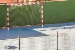 Football field in a city for sports on a hard court stock images