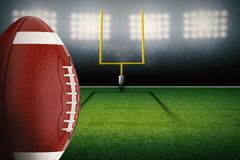 Football on field. 3d rendering american football ball with field goal post stock photography