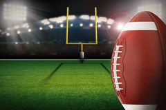 Football on field. 3d rendering american football ball with field goal post Royalty Free Stock Image
