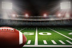 Football on field. 3d rendering american football ball on green field stock photo