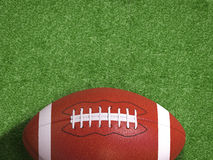 Football on field. 3d rendering american football ball on green field Stock Photography