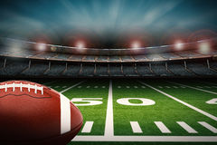Football on field. 3d rendering american football ball on green field Royalty Free Stock Images