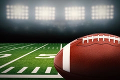 Football on field. 3d rendering american football ball on green field Royalty Free Stock Photos