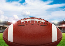 Football on field. 3d rendering american football ball on green field with blue sky Stock Image