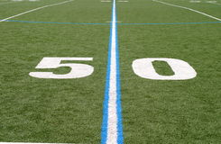 Football Field Fifty. Green football field with large yard numbers Royalty Free Stock Image