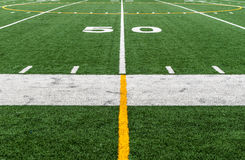 Football field at fifty 50 yard line stock image