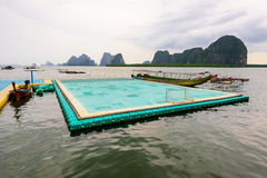 Football field floating on the sea Stock Images