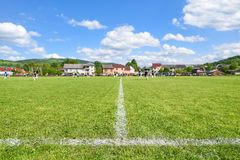 Football field with focus on the sideline, background with text space Royalty Free Stock Images