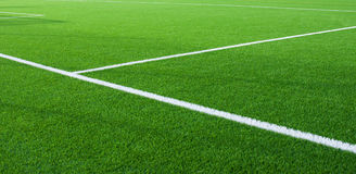 Football field fragment with  white lines. Football field fragment close up  white lines Stock Photography