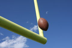 Football Field Goal. American Football kicked through the goal posts Royalty Free Stock Photo