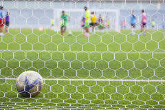 Football field and goal net. Blurred image of football field and goal net Stock Image