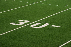 Football field. Grass football field with Thirty yard line Royalty Free Stock Image