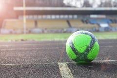 Football field green grass sport stadium. Soccer ball on a field of green grass sport stadium wallpaper Stock Photography